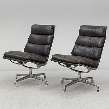 A pair of 'EA 216 soft pad chairs' by Charles & Ray Eames, Herman Miller.