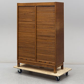A first half of the 20th century oak cabinet.