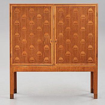 "HANS J WEGNER, an ""Acorn"" cabinet by cabinetmaker Mikael Lauersen, Denmark 1940's."