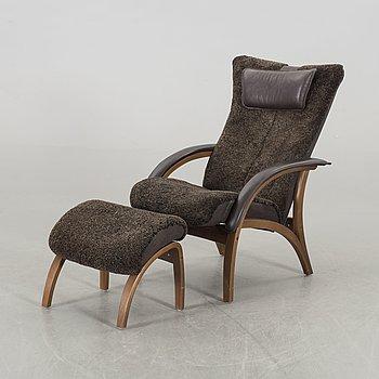 A Norwegian Brunstad Delta Adventure armchair and stool, 21st century.
