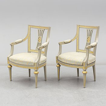 A pair of armchairs. One Gustavian, late 18th Century and one copy, circa 1900.