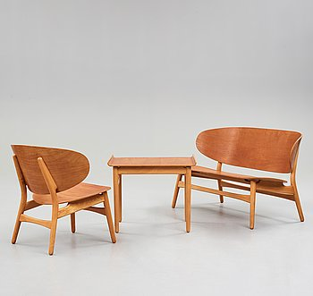 "A HANS J WEGNER, a  ""Shell set/ Skalsæt"" comprising a sofa, a chair and a table, Fritz Hansen, Denmark 1950's."