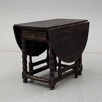 A 18th Century Baroque gate leg table.