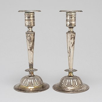 A pair of silver candlesticks by Gustaf Folcker, Stockholm 1829.