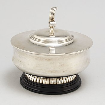 A parcel gilt silver bowl on a wooden base by CG Hallberg Stockholm 1934.