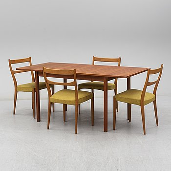 A 1960's composite dining set with a teak table and four oak chairs.