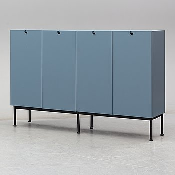 A pair of cabinets on a metal stand by Jonas Bohlin.