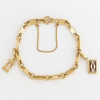 Cartier 18K gold charm bracelet.