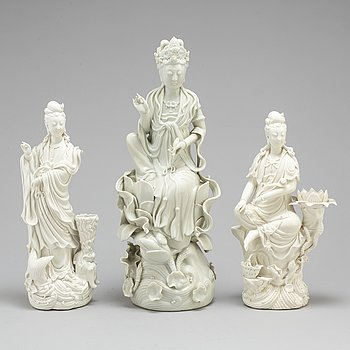 Three Chinese blanc de chine figures of Guanyin, 20th century.