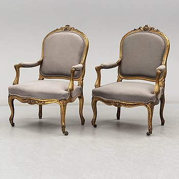 A pair of late 19th / early 20th century Louis XV-style armchairs.