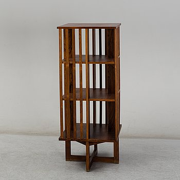 A second half of the 20th century roosewood swivel book case.