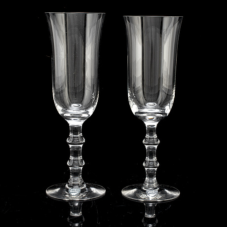 A set of twelve champagne glasses by simon gate.
