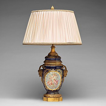 312. A French bronze mounted porcelain table lamp, late 19th Century, signed Thuilier.
