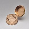 Three early 19th century gold pieces: snuff-box, case with tooth-picker and button.