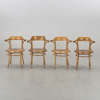 A set of four Cosmos arm chairs first half of the 20th century.