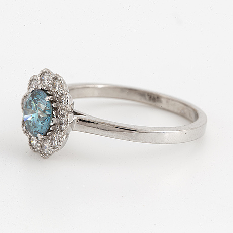 Ring with colour treated blue brilliant cut diamond