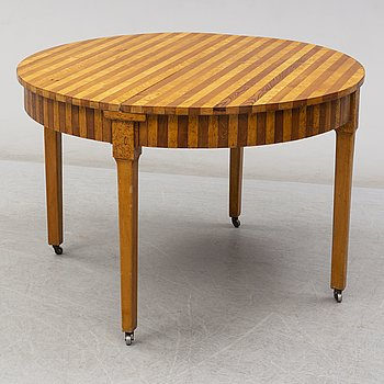 a dining table from the early 20th century.