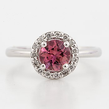 Round faceted pink tourmaline and brilliant-cut diamond ring.