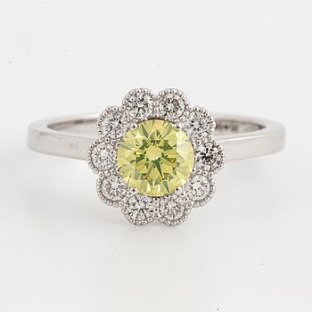 An 18K white gold set with a color treated yellow diamond.