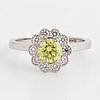 An 18k white gold set with a color treated yellow diamond