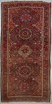 A CARPET, an antique/semi-antique West Iran, ca 493-487 x 248-246 cm.