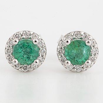 Brilliant-cut diamond and emerald earrings.