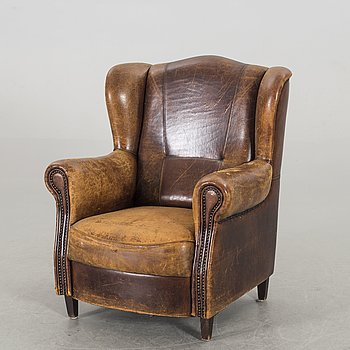 A LEATHER ARMCHAIR, late 20th century.
