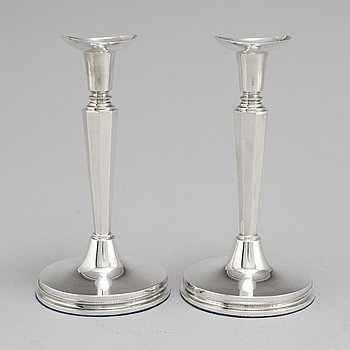A pair of silver candle sticks by Eric Löfman, Uppsala 1961.