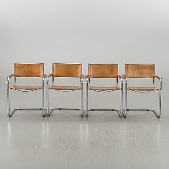 A set of four leather armchairs alter part of the 20th century.