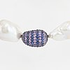 Cultured baroque freshwater pearl necklace, clasp gaudy white gold with sapphires.