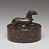 A bronze figure of a reclining dog, 17/18th century.