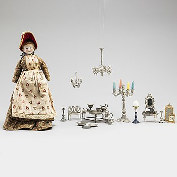 a sett of dollhouse accessories and a doll, 19th-20th cntury.