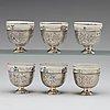 A set of six ottoman parcel-gilt silver xarfs with russian kuznetzov porcelain cups, c. 1910.