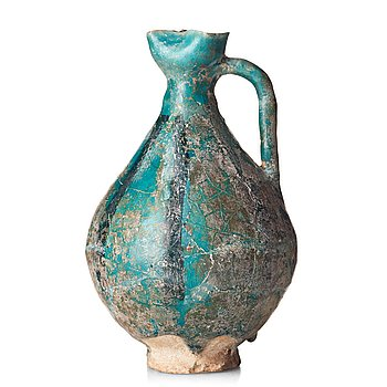 286. A EWER, pottery, Persia 13th century, probably  Kashan, height ca 17,5 cm.
