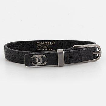 CHANEL, a leather bracelet.