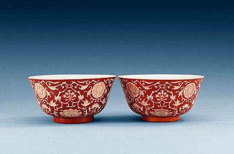 Two reserved-decorated coral-ground bowls, qing dynasty with daoguang´s seal mark and of the period (1821-50).