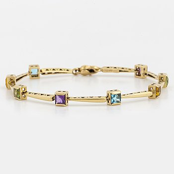 18K gold Italy bracelet including periodot, citrine and amethyst.