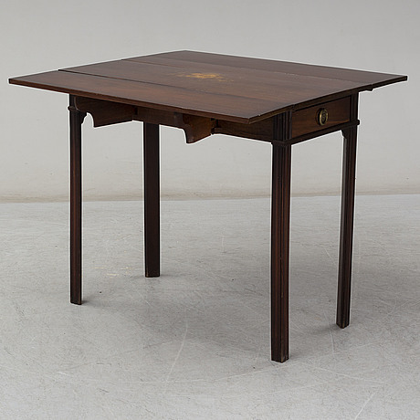 A late gustavian mahogany dropleaf tablefrom around 1800.