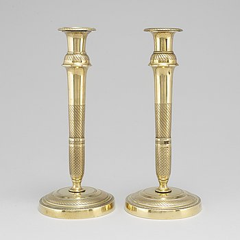 A mid 19th Century pair of brass candle sticks.