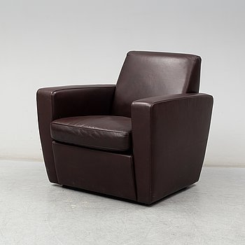 A contemporary brown leather easy chair from Moroso.
