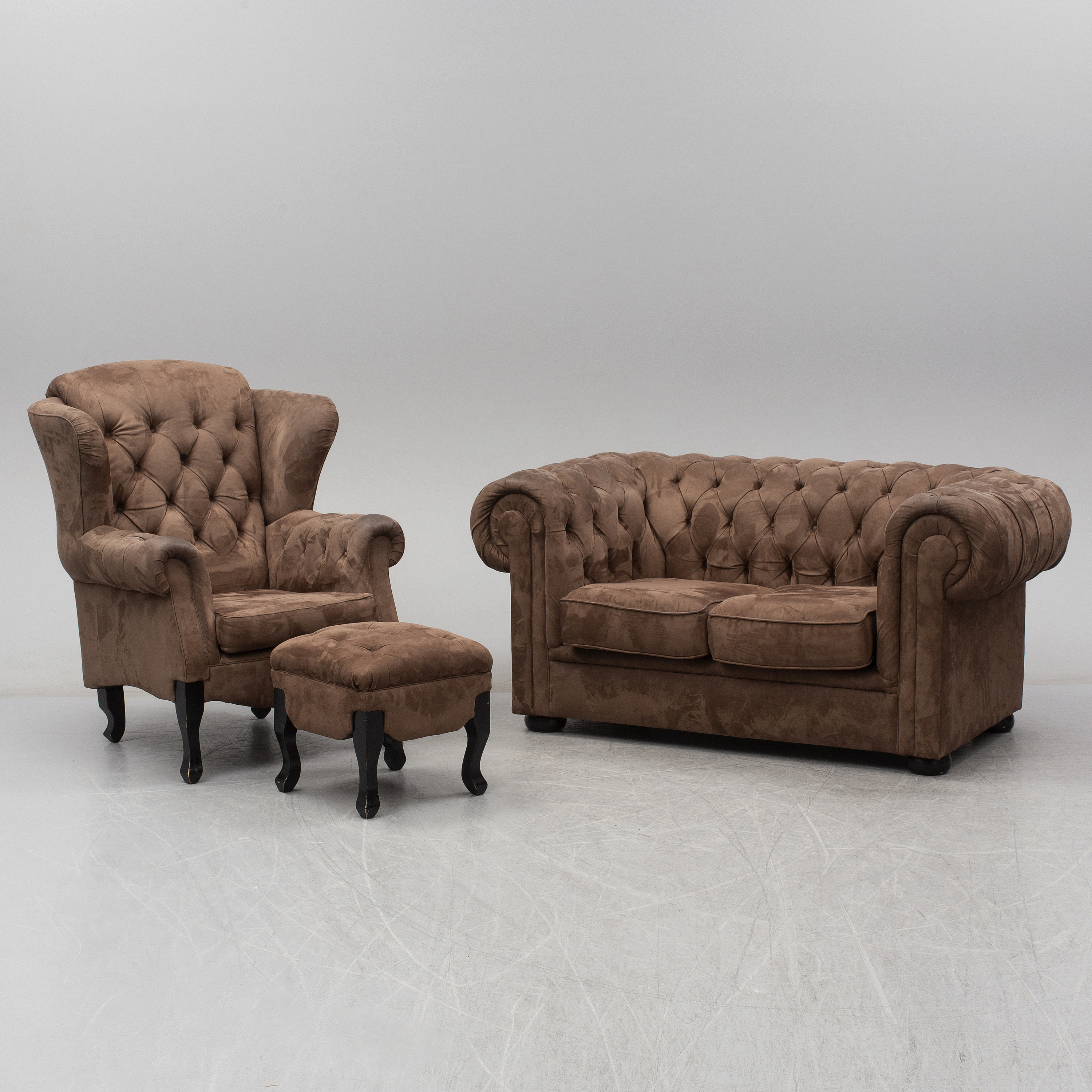 A Chesterfield Sofa And An Armchair With Foot Stool 2000s