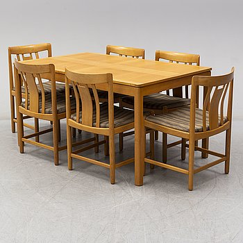 A oak dining table and six chairs designed by Gunnar Myrstrand, Källemo, 1960s.