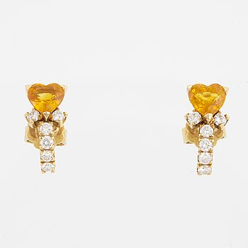 A pair of heart shaped yellow sapphire and brilliant-cut diamond earrings.