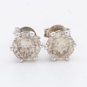 EAARINGS 14K whitegold approx 1,5 ct in total approx N-O very light brown,  Inclusions.