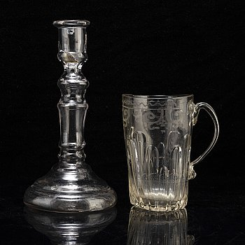 A glass cup with handle and a glass candle stick, 18/19th Century.