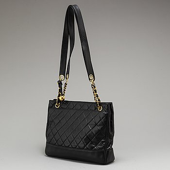 CHANEL, a black leather bag.