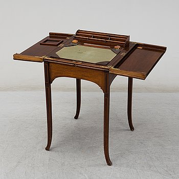 A 20th century writing desk signed Kirby, Beard & Co LD.
