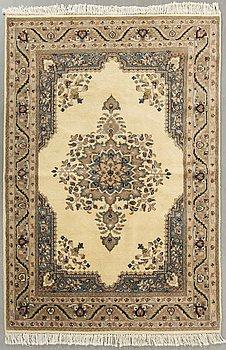 An oriental carpet ca 192 x 127 cm.