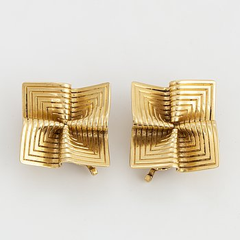 A pair of Tiffany & Co 14K gold earrings.