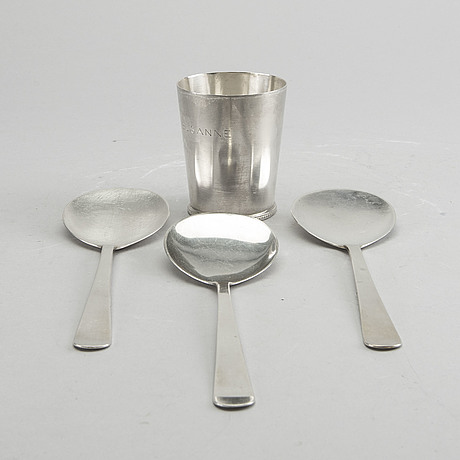 A swedish 20th century sterling set of three sandwich spoons ad a beaker mark of w nilsson lund 1965, 1967 and 1946,